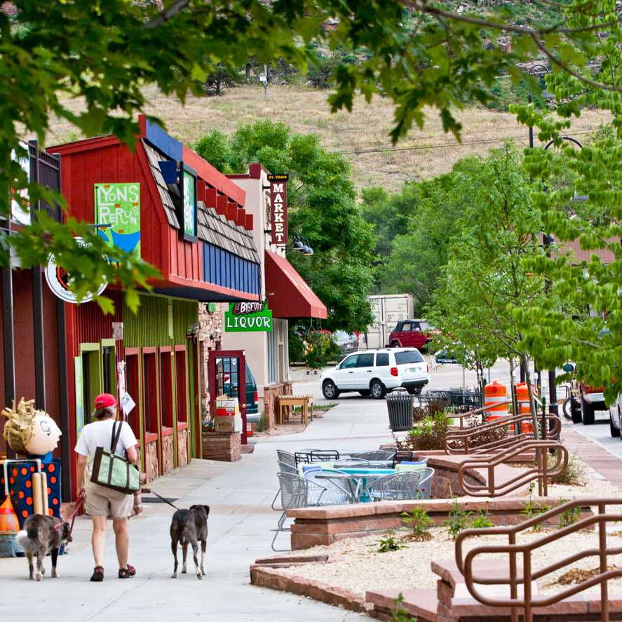 A photo of businesses on Mainstreet in downtown Lyons, Colorado.